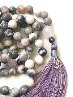 Pink Zebra Jasper Mala - Rose Quartz and Hematite Mala Beads - Mala To Bring Balance - Hand Knotted - 108 Bead Mala - 8mm length 40 - 6mm length 31 This Pink Zebra Jasper beaded Mala necklace is a superb blend of timeless chic and earthy charm. It has been handcrafted in artistic