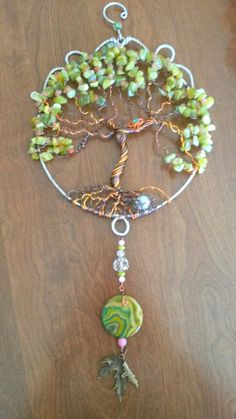 Wire wrapped Tree of life sun catcher with rose quartz chips and green gade chips, agate accent pendant bird's nest.