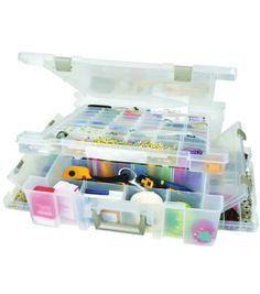 Lid and base each have separate access.  Two side bins with dividers, allow for multiple storage options.  Comfortably fits on top of Super Satchel cube. Stackable.  Features a divided top and bottom.