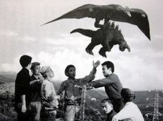 Giant people argue while Rodan makes off with Godzilla