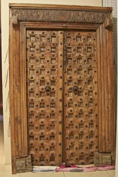 Lovely Carved Wood and Iron Double door from India. Very tall with carved top panel.