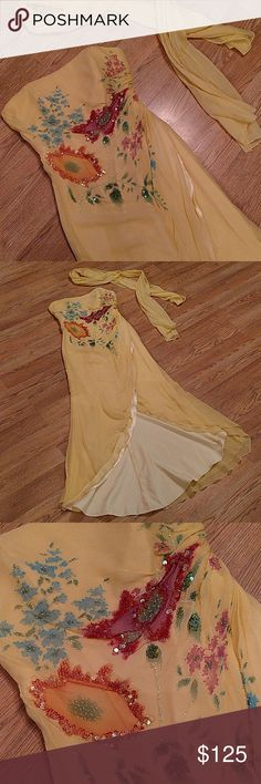 "✝️ Silk Jovani gown Gorgeous silk gown with hand beading and sequins. Strapless, back zipper, and side ruching leading to open bottom. 2 layers of golden silk accented with shiny yellow lining. Scarf included - 75"" x 20"".  Bust - 18"", waist - 15"", length - 50"". Gently worn. Jovani Dresses"
