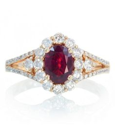 Ruby oval halo diamond solitaire split shank rose gold engagement promise ring.. undecided about this one!