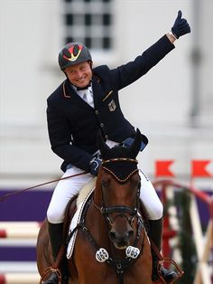Equestrian  Michael Jung of Germany riding Sam celebrates winning the gold medal in the Individual Jumping Equestrian final on Day 4 of the London 2012 Olympic Games at Greenwich Park