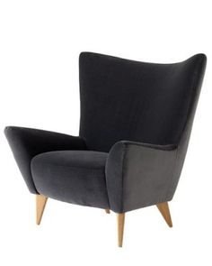 """Matador Chair by Terence Conran.    """"So peaceful and supportive,"""" raves Joung, assuming a meditative palms-up posture as she sits. """"It may not look serene, with its pointy ends, but the comfort is phenomenal."""" Crediting the chair's lower height (39"""" tall) and retro style (a """"twist on modern""""), she pictures this piece fitting into a variety of settings. $1,595; conranusa.com."""