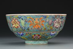 China, Famille Rose bowl, flared sides on footed base, densely decorated with floral pattern, peach motif in the center and mark on base. Height 3 in., Diameter 6 in.