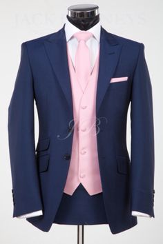 Blue and Pink 3 piece Suit. Could also match the vest with groomsman. http://www.jackbunneys.co.uk/