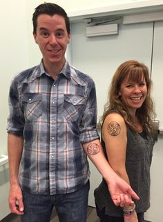 Library Journal Movers and Shakers (2013 & 2015), Doctor Who Fans, and Teacher-Librarians Matthew Winner (Maryland) and Sherry Gick (Indiana) show off their tattoos that say Mover and Shaker in Gallifreyan, the language of Time Lords.