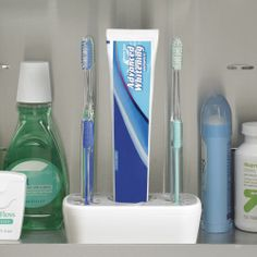 Medicine cabinet toothbrush and toothpaste organizer