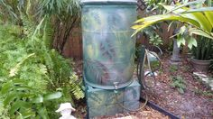 Rain Barrel. Hold leaf to barrel and spray paint. Remove leaf and  try another leaf. Spray paint support blocks to match. Blends into nature.
