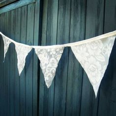 Made from recycled lace curtains using only the most decorative of pieces, each triangular flag has been hand picked to compliment the flags on either side allowing a harmonious variation of delicate vintage patterns. It is elegantly stitched on white sil