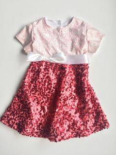 A personal favorite from my Etsy shop https://www.etsy.com/listing/493122486/red-sequined-hearts-dress-baby-girls