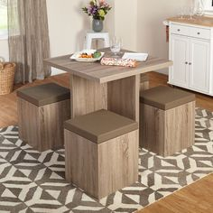 Create a beautiful interior dining space with this stylish and contemporary 5-piece dining set. Save space with the matching ottomans that feature a convenient storage capacity. Perfect for an apartment or small home, this furniture is sure to accentuate your existing home decor. Constructed of engineered wood with a reclaimed style laminate finish, vinyl, foam.