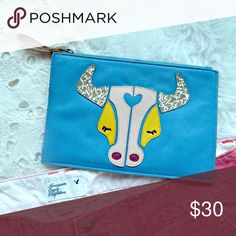 """Anthropologie Miss Albright Bohemian  Clutch New with out tags. *EXTERIOR MADE OF VERY SOFT AND BEAUTIFUL LEATHER IN A PRETTY MEDIUM BLUE SHADE *TAURUS LOGO SEWN ON FRONT END WITH VARIOUS RICH LEATHER COLORS *BACK OF BAG HAS A LEATHER GOLD AND WHITE FLORAL PATTERN *ZIPPER TOP CLOSURE WITH METALLIC LEATHER PULL TAB *1 END OF BAG HAS A PLEATED SIDE FOR EXTRA FULLNESS INSIDE BAG *INTERIOR FULLY LINED IN A BLACK FABRIC.   Depth:1/8"""" Length:8 1/4""""Material:LEATHER Strap Drop:2.5"""" Height:5.5""""…"""