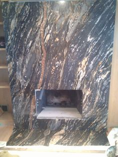 A slab of granite used as a fireplace surround