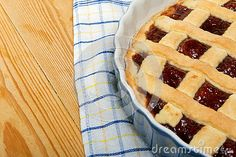 Homemade cherry pie on wooden table piece
