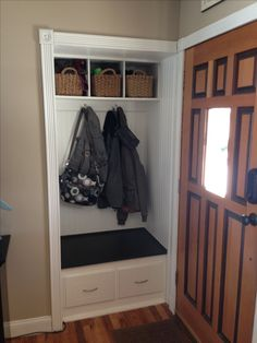 Small front hall closet turned in to mini mud room! Note the moulding.