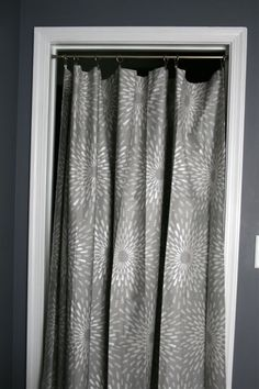 Using a curtain instead of door. I think I am going to do this for all of our closets!