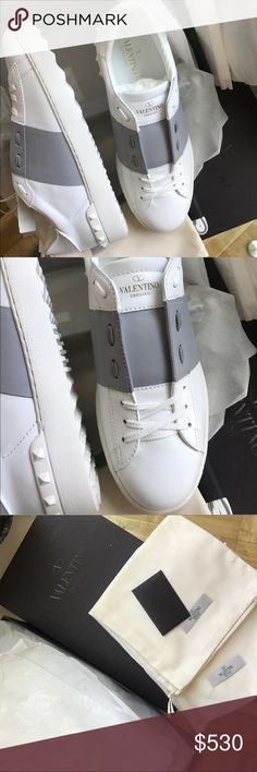 Valentino White and Grey Open Sneakers Brand new Valentino low-top brushed leather sneakers in white. EU Size 42.  Round toe. Tonal lace-up closure. Logo stamp in gold-tone at padded tongue. 100% authentic. No trades. Valentino Shoes Sneakers