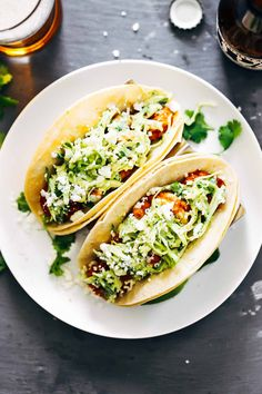 Spicy Shrimp Tacos with Garlic Cilantro Lime Slaw - ready in about 30 minutes and loaded with flavor and texture. 350 calories for 2 tacos.