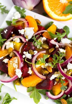 Beet Salad with Goat Cheese and Orange Vinaigrette also has red onion, and a sprinkling of pistachios. This Beet Salad is great on a bed of baby arugula. Beet Goat Cheese Salad, Beet Salad With Feta, Roasted Beet Salad, Beet Salad Recipes, Mint Salad, Healthy Recipes, Orange Salad, Salads With Beets, Salad With Oranges