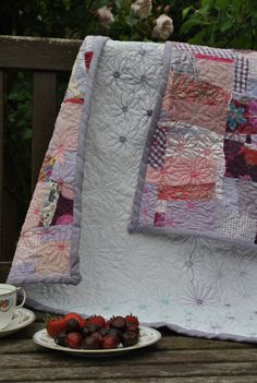 Pink & lilac scrap quilt/throw, machine-embroidered garden of flowers .  via Etsy.
