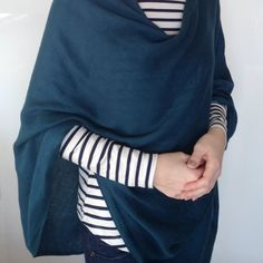 Turn a pashmina into a 6-way convertible scarf - it only takes 5 minutes! Wear it as a cape, a shirt, a shawl... and the list goes on.