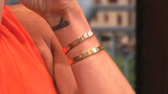 Kelly Ripa's Cartier Love Bracelets. Gifts from her husband Mark Consuelos.