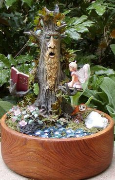 We mostly watch the beautiful fairy gardens in the movies and TV Shows. Many people consider that fairy gardens can only be seen on fiction stories. Nowadays, it is possible to create fairy gardens according to all of your requirements. Indoor Fairy Gardens, Mini Fairy Garden, Fairy Garden Houses, Miniature Fairy Gardens, Garden Art, Garden Design, Garden Ideas, Tree Garden, Fence Garden