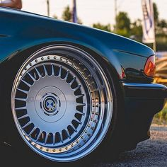 BMW e38 on modified factory alloys.