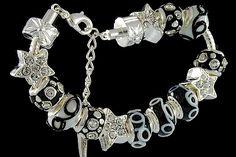 silver plated items: bracelet with lobster, enamel beads with cubic zirconia, star beads with cubic zirconia, locks. Five glass beads with 925 silver core. Pandora Like Bracelets, Cheap Fashion Jewelry, Fashion Jewellery Online, Italian Jewelry, Murano Glass Beads, Wholesale Jewelry, Glass Jewelry, Locks, 925 Silver