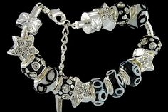 silver plated items: bracelet with lobster, enamel beads with cubic zirconia, star beads with cubic zirconia, locks. Five glass beads with 925 silver core.