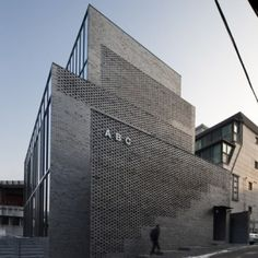 Perforated brick stairwells front  Wise Architecture's ABC office block