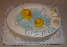 Rubber ducky bathtub cake cakepins.com