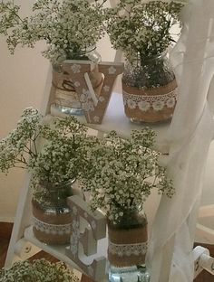 So simple yet so effective these glass jars are decorated with burlap and lace. They can be filled with flowers or candles and look simply stunning