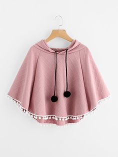 Blouses by BORNTOWEAR. Pom Pom Trim Embossed Cape Hooded Top