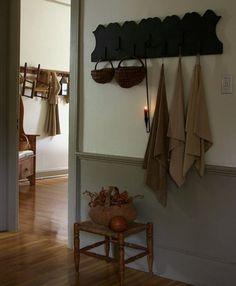 FARMHOUSE – INTERIOR – the foul rack is inside the entry hall or mudroom of a farmhouse.