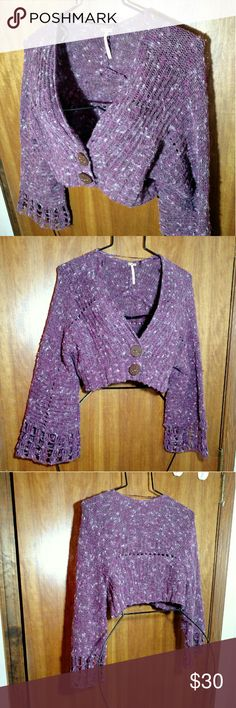 Free People Cropped Purple Confetti Cardi Sweater Awesome cropped long bell sleeve cardigan sweater knit in shades of purple and pink from a crazy complicated yarn. It's got bunches of color as well as long fibers and is made from cotton, nylon, acrylic, wool, mohair, and alpaca. Wow. Multiple knit styles. Fastens in front with 2 oversized buttons.  I think it's new without tags as it still has the tag holder thing attached just no tag, but in any case, no issues. Size extra small by Free…