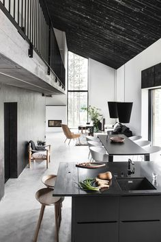 Open concept black & white kitchen/ dining/ living