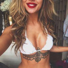 Under breast tattoo