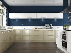 Dark blue painted kitchen with cream cabinets and modern design.