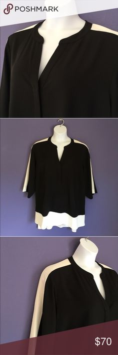 """🆕 Calvin Klein Black & Cream Blouse NWOT - You will definitely draw attention in this gorgeous blouse.  The cream accent on the shoulders,arms and bottom make this top extremely classy!   There is a hi/lo effect from front to back.  Very flattering blouse!  The v-neck goes into a button down. Comes with extra button.  Measurements(Flat):  Length - 28"""" to 33""""/Bust - 29""""/Waist - 29"""" Calvin Klein Tops Blouses"""