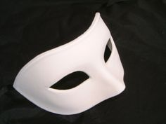 £7.99 from www.maskparty.co.uk. Probably paper mache
