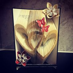 Bookfolding made by me! I also made the pattern  #bookfolding #book #folding #art #butterflies #heart #flower