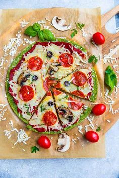 Top view of broccoli pizza crust on parchment paper with pepperoni, mushrooms and tomatoes Broccoli Pizza, Mushroom Broccoli, Vegetable Pizza, Keto Recipes, Healthy Recipes, Diet Plan Menu, Entrees, Breakfast Recipes, Stuffed Mushrooms