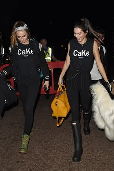 BFFs Kendall Jenner and Cara Delevingne wearing CaKe graphic T-shirts.