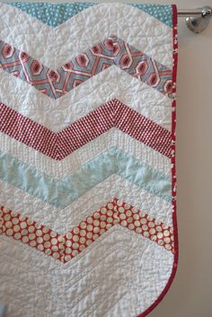 Gentle chevron quilt with wonderfully rounded corners and great quilting.