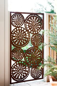 Kuru gate, laser cut steel. Rusty outdoor art