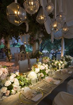 Hilary Duff: The reception was held in a muslin draped wooden pergola, dripping with greenery, glass domes and candles. Centerpieces of dahlias, regalias, roses and magnolia leaves lined the tables giving the party a rustic organic feel. brPhoto: HilaryDuff.com