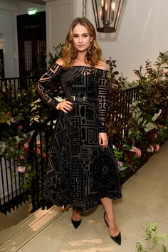 Lily James is wearing a long sleeve off shoulder Burberry tea length dress with a velvet design. I adore this dress and Lily James! The dress is fun, edgy, and unique! Lily is a great actress and always looks stunning on the red carpet! Lily James, Celebrity Red Carpet, Celebrity Dresses, Celebrity Style, Celebrity Beauty, Zoe Saldana, Burberry Dress, Glamour, Tea Length Dresses